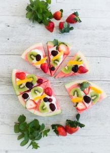 Party food does not get a whole lot easier or more versatile than this Watermelon Pizza! Healthy, simple and fun, kids can also decorate it themselves.