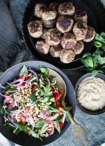 This Lamb Kefta is an easy to make, nourishing meal that my whole family loves. Serving it with the Tomato Salad and Tahini Sauce is a match made in heaven.