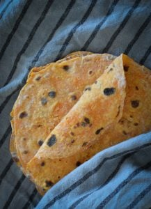 These Sweet Potato Roti Flatbreads are a quick and easy wrap to make. Great warm as a side with a curry or store and use for school lunches.