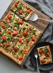 This Zucchini, Goat Feta and Pine Nut Tart is a quick and easy recipe makes a beautiful light lunch or dinner and is one of my favorite ways to enjoy nourishing microgreens.