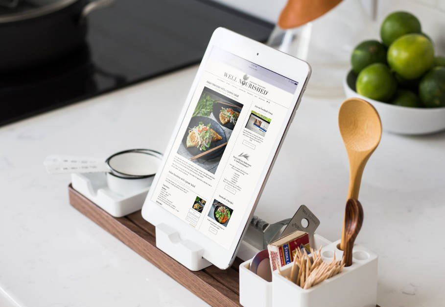 ipad with well nourished family membership displayed in the kitchen